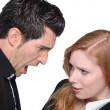 Upset young woman with a young man - Stock Photo