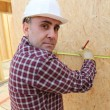 Builder measuring a wall — Stock Photo