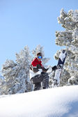 Man snowboarding down snowy hill — Stock Photo