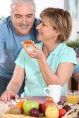 Senior couple having breakfast — Stock Photo