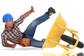 Laborer tumbling down from a barrow — Stock Photo