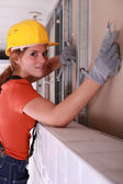 Electrician installing an electrical supply system — Stock Photo