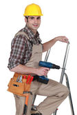 Man standing on ladder — Stock Photo