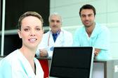 Team of three doctors — Stock Photo
