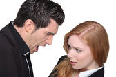 Upset young woman with a young man — Stock Photo