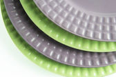 Pile of gray and green plates — Stock Photo
