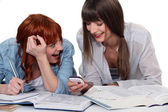 Two girlfriends studying and having fun together — Stock Photo
