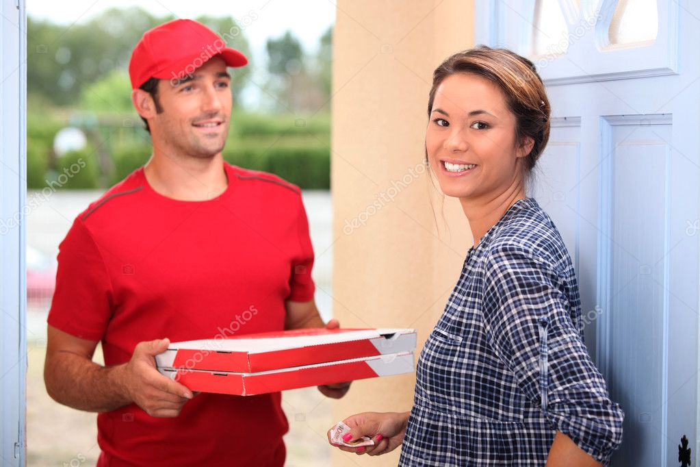 Young man delivering pizza — Stock Photo #10893402