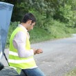 Stock Photo: Mwith car breakdown