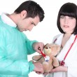 Doctor healing teddy bear — Stock Photo #10901492