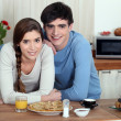 Young couple having pancakes for breakfast — Stock Photo