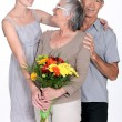 Mother with flowers — Stock Photo
