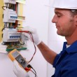 Stock Photo: Electriciinspecting fuse box