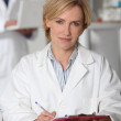 Doctor writing report — Stock Photo