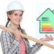 Stock Photo: Womholding energy rating information and sledge-hammer