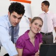 Stock Photo: Businesspeople working together on project