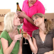 Stock Photo: Young celebrating on moving day