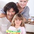 Family with puzzle — Stock Photo #10907166