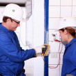 Stock Photo: Electricians with voltmeter