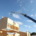 Crane lifting the framework of a house — Stock Photo #10907503