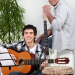 Stock Photo: Father and son in music rehearsal
