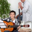 Royalty-Free Stock Photo: Father and son in music rehearsal