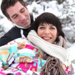 Flirtatious couple playing in snow — Stock Photo #10907645