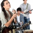 Stock Photo: Female vocalist in band