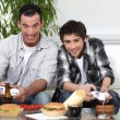 Father and son playing games together — Stock Photo #10908491