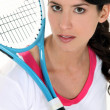 Stock Photo: Womholding tennis racket