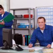Apprentice and trainer in workshop — Stock Photo