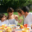 Family having brunch outside on sunny day — Stock Photo #10908939