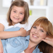 Young mother and daughter at home — Stock Photo #10908962