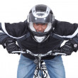 Motorcyclist on a push bike — Stock Photo