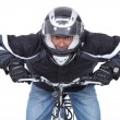 Motorcyclist on a push bike - Stock Photo