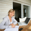 Woman using a laptop at home — Stock Photo #10909788