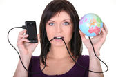 Woman connecting mobile globe — Stock Photo