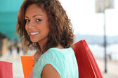 Woman enjoying lavish shopping trip — Stock Photo