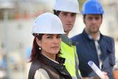 Construction team on site — Stock Photo