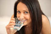 Brunette drinking a glass of water — Stock Photo