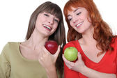 Women with apples in hand — Stock Photo
