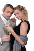 Couple with champagne — Stock Photo