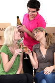 Young celebrating on moving day — Stock Photo