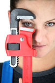 Craftswoman holding a spanner — Stock Photo