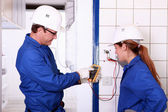 Electricians with voltmeter — Stock Photo
