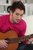 Man playing the acoustic guitar — Stock Photo