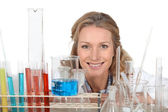 Woman with a variety of laboratory equipment — Stock Photo
