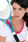 Woman holding a tennis racket — Stock Photo