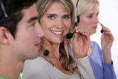 Three call-center workers — Stock Photo