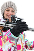 Woman carrying her skis — Stock Photo